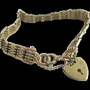 5 bar 9k gold gate bracelet heart padlock pendant charm vintage 1973 English hallmark.