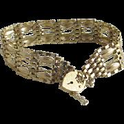 9k gold 6 bar gate bracelet heart padlock clasp vintage 1989 English hallmark.