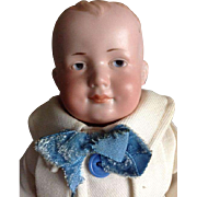 AM boy doll with a special number 600 and a closed mouth