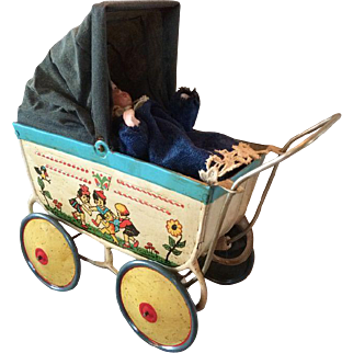 Antique Tin baby stroller with childrens scenes with a lovely Heubach doll with a closed mouth