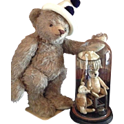 Lovely large Steiff bear with two antique bears with an umbrella and a miniature chair under a bell jar - ca 1900.