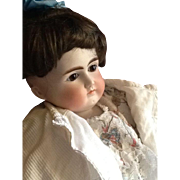 Beautiful Belton doll with a closed mouth.