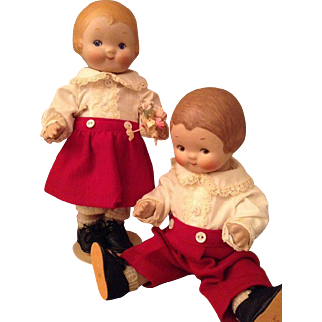 Gorgeous character boy and a girl doll.