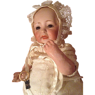 Gorgeous J. D. Kestner Character baby doll with an open closed mouth solid dome head with brown glass set eyes- 10.