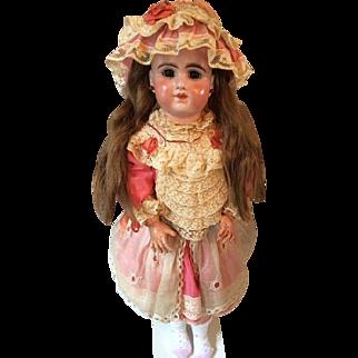 Jumeau SFBJ doll with a closed mouth and a mama papa voicebox.