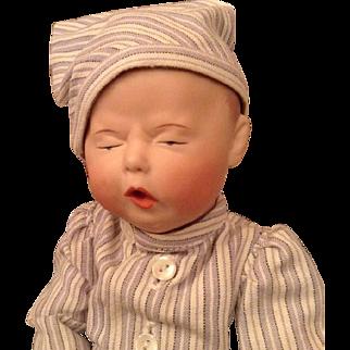Cute sleepy character boy doll.
