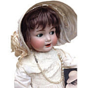 Antique character doll from Kley & Hahn with flirty eyes - 680.