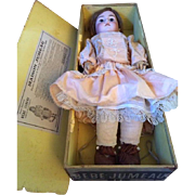 Tête Jumeau doll in Jumeau box with mama and papa strings
