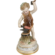 Meissen Cupid Blacksmith Forging a heart