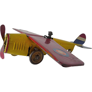 Antique Painted toy airplane with a friction hill climber mechanism