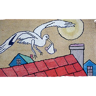 Hooked rug of a Stork delivering a Baby from a Quebec collector's estate auction.