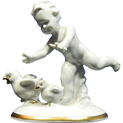 Vintage White Porcelain Figurine of a Little Boy Chasing Hens – Germany 20th Century