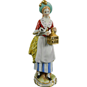 Vintage Hand Painted Capodimonte Porcelain Figurine of a Bird Seller Italy 20th Century