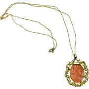 An Antique Cameo Brooch with Chain Orange Hand Carved Coral Mounted in 10 Karat Gold & Pearls Europe