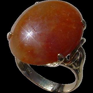 Red Jadeite 17.58 Carat Set In 14K Gold Ring.