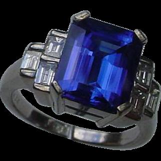 Beautiful 4.34 Carat Emerald Cut Tanzanite Set In An 18K White Gold Ring w/ Diamonds