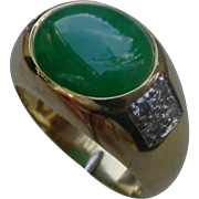 Green Jadeite A-Grade 5.8 Carat Set In An 18K Gold Ring With Diamonds.