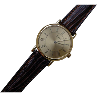 Ladies Piaget 18K Gold Very Thin, Mechanical Wind Movement.
