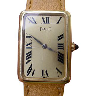 Ladies Piaget 18K Gold Rectangular Case, Large Roman Numerals Dial, Mechanical Wind Movement.