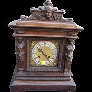 C. 1910-1920 Carved Walnut Figural Shelf Clock