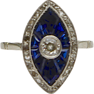 An Antique Edwardian Carved Sapphire and Diamond ring