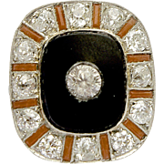 A Vintage Art Deco Diamond Onyx and Coral ring in Platinum