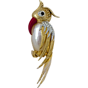 A Vintage signed Marcel Boucher Gold Tone Mother of Pearl 'Jelly Belly' bird brooch from the Exotic Bird range