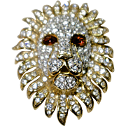 A Vintage signed Attwood & Sawyer Gold tone and pave set clear Swarovski crystals Lion head figural brooch