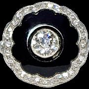 A Vintage Art Deco Circular Black Onyx and Diamond Ring
