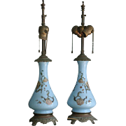 Pair of antique French Opaline blue glass lamps with hand painted flowers