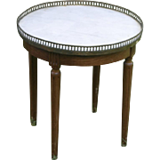 Round marble top side table, Hollywood Regency style with brass pierced gallery