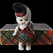 Vintage Miniature Tartan-clad Bisque Kewpie Doll in Original Tartan Box