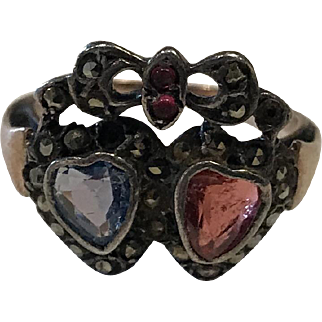 "Victorian Circa 1880 Rose Gold ""Two Hearts"" Ring with Sapphire, Rubies, Rose Cuts, & Bow Crest"