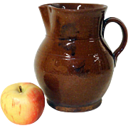 Large 19th C. Manganese Decorated Redware Pitcher