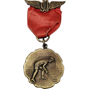 Vintage Brass Ice Hockey Medal J.J.O with Wings circa 1900