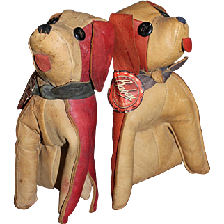 A Pair of Twin French Spaniel Leather Seated Toy Dogs by Babey