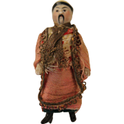 A Small All Bisque Oriental Man with a Moulded Hat and Moustache in Original Clothing, 3 inches