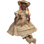 An Antique English Poured Wax Doll in her Original Clothes and her Wooden Box, 14 inches