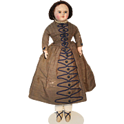 Early Wax Over Paper Mache Doll in Original Dress, 24 1/2 inches tall