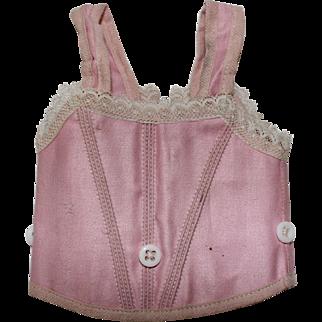 An Antique Pink Dolls Corset