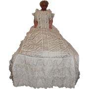 A Fine Pierotti Poured Wax Royal Baby Doll in the Finest Gowns, English circa 1870's, doll 22 inches