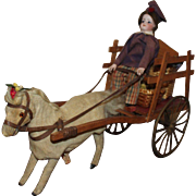 French Mechanical Toy 'Little Boy Flower Seller with Pony and Cart' Fine Doll, circa 1890, 16 inches