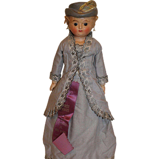Wax over Composition Doll with Molded Hat and feather, Mohair Curls and Pierced Ears, 14 inches