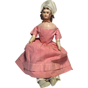 A Rare Antique Wax over Paper-Mache Doll with small breasts, 22 inches