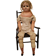 A Wax Over Composition Shoulder Head Doll with Sleeping Eyes, 21 inches, TLC