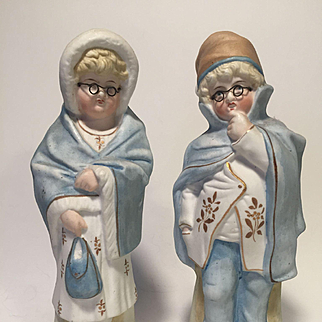 Pair of Children Dressing up as Mother and Father Figurines