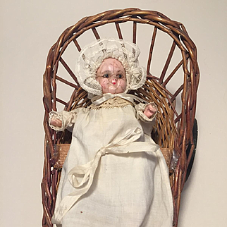 A Small Antique Mechanical Wax over Composition Baby Doll in a Crib on Wheels, Push Along Toy, German c. 1880's