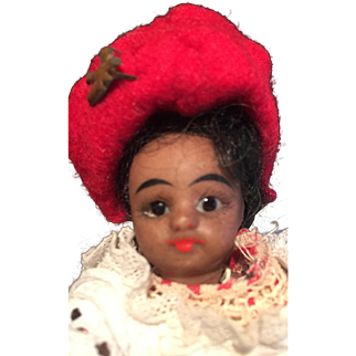 A Darling Mulatto Closed Mouth, Bare Foot All Bisque Doll, 4 1/2 inches