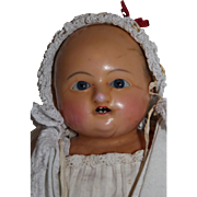 An Early Antique Wax over Paper Mache, Sonneberger Taufling Motchmann Doll