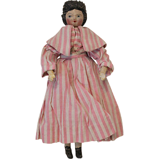 A Delightful Antique Carved Peg Wooden Doll, 10 1/2 inches
